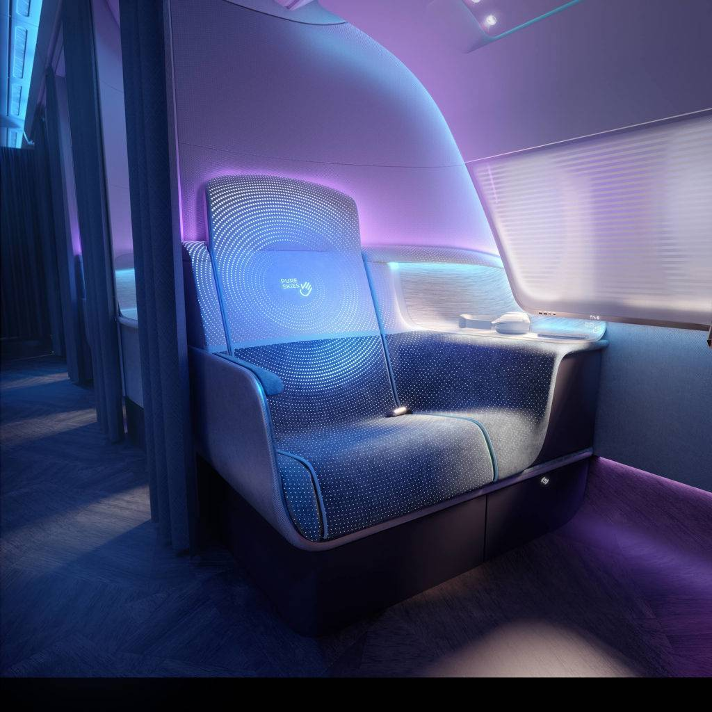 A business class seat, on which is displayed a Pure Skies logo, indicating the seat has been cleaned