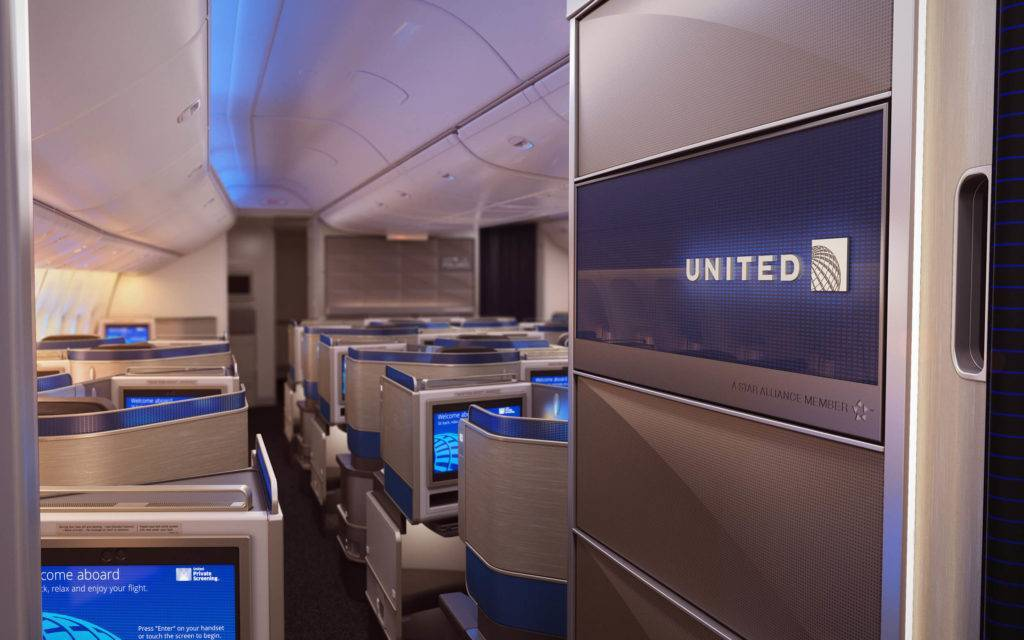 United brand panel at the entrance to the aircraft cabin